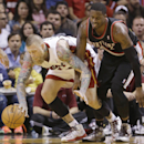 Miami Heat forward Chris Andersen (11) and Portland Trail Blazers guard Wesley Matthews (2) battle for a loose ball during the first half of an NBA basketball game, Monday, March 24, 2014 in Miami The Associated Press