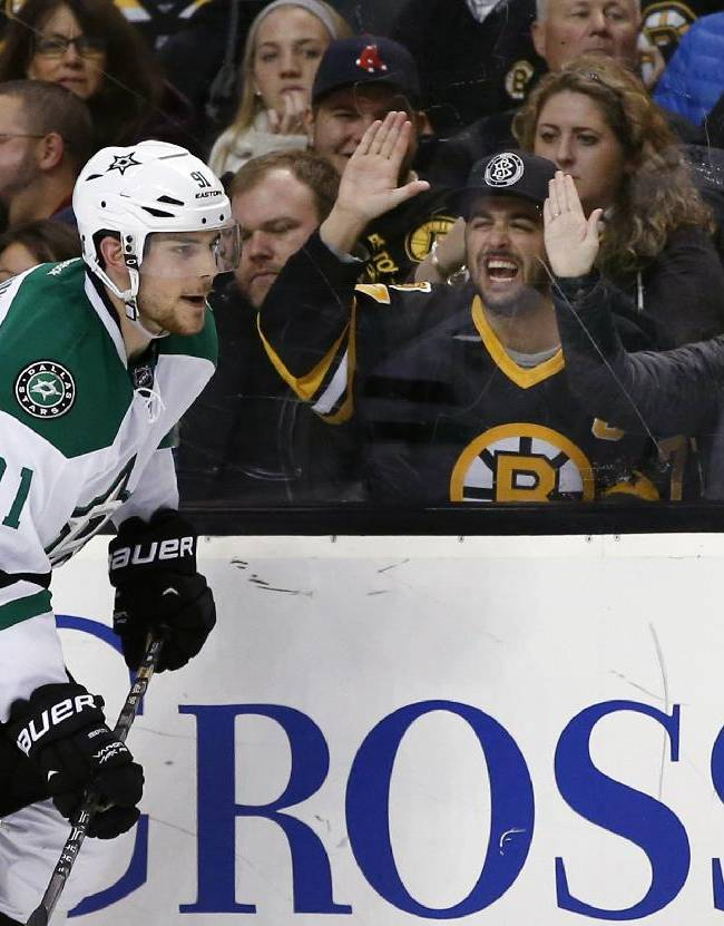 Fans taunt former Boston Bruin and current Dallas Stars center Tyler Seguin (91) during the third period of the Bruins' NHL hockey game against the Boston Bruins in Boston on Tuesday, Nov. 5, 2013
