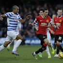 Queens Park Rangers' Karl Henry, left, competes for the ball with Manchester United's Angel Di Maria during the English Premier League soccer match between QPR and Manchester United at Loftus Road stadium in London, Saturday, Jan. 17, 2015