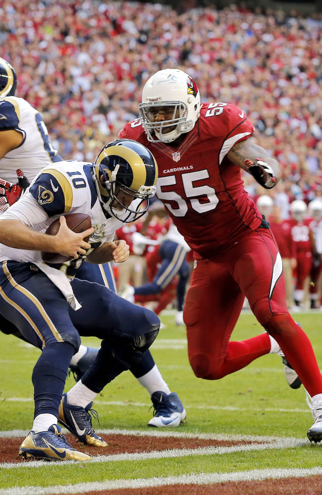 Arizona Cardinals outside linebacker John Abraham (55) sacks St. Louis Rams quarterback Kellen Clemens (10) in the end zone for a safety during the second half of an NFL football game, Sunday, Dec. 8, 2013, in Glendale, Ariz