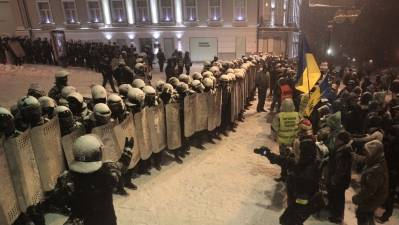 Tense Standoff in Kiev As Police Encircle Camps