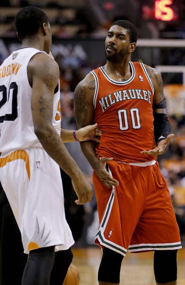 Phoenix Suns' Archie Goodwin and Milwaukee Bucks' O.J. Mayo (00) are separated by the referee during the second half of an NBA basketball game, Saturday, Jan. 4, 2014, in Phoenix. The Suns won 116-100