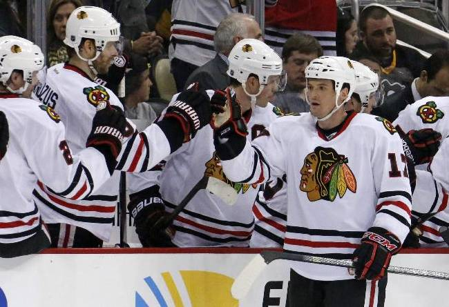 Chicago Blackhawks' Sheldon Brookbank (17) celebrates with teammates as he returns to the bench after scoring in the second period of an NHL hockey game against the Pittsburgh Penguins in Pittsburgh, Sunday, March 30, 2014