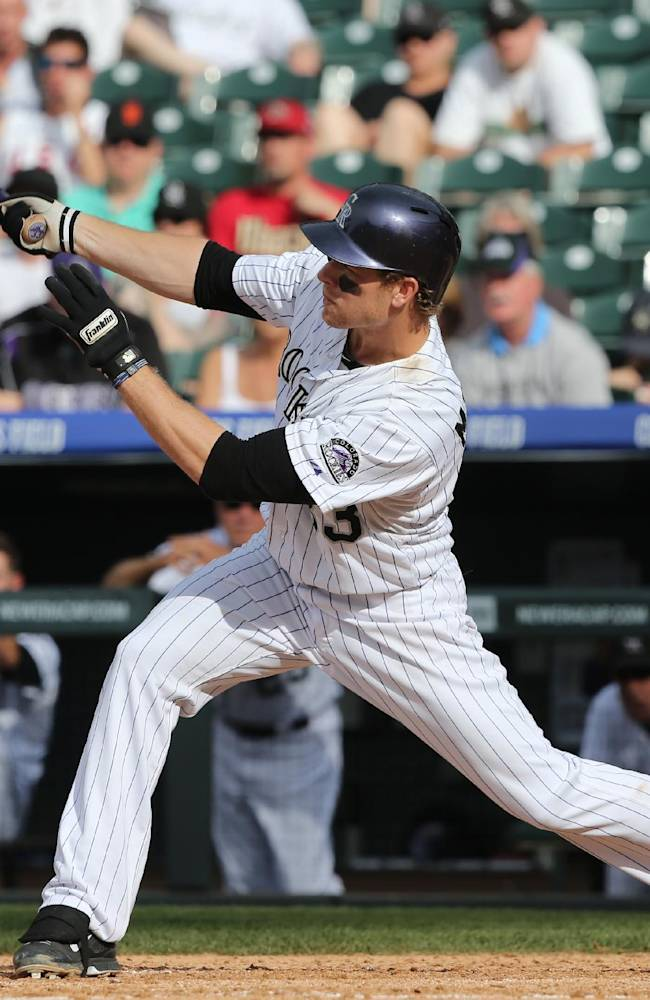 Colorado Rockies' Justin Morneau follows the flight of his solo home run against the New York Mets in the ninth inning of the Mets' 5-1 victory in a baseball game in Denver, Sunday, May 4, 2014