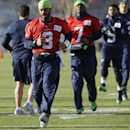 Seattle Seahawks quarterback Russell Wilson (3) and backup quarterback Tarvaris Jackson (7) jog during warm-ups before NFL football practice, Wednesday, Jan. 14, 2015, in Renton, Wash. The Seahawks host the Green Bay Packers Sunday in the NFC Championship