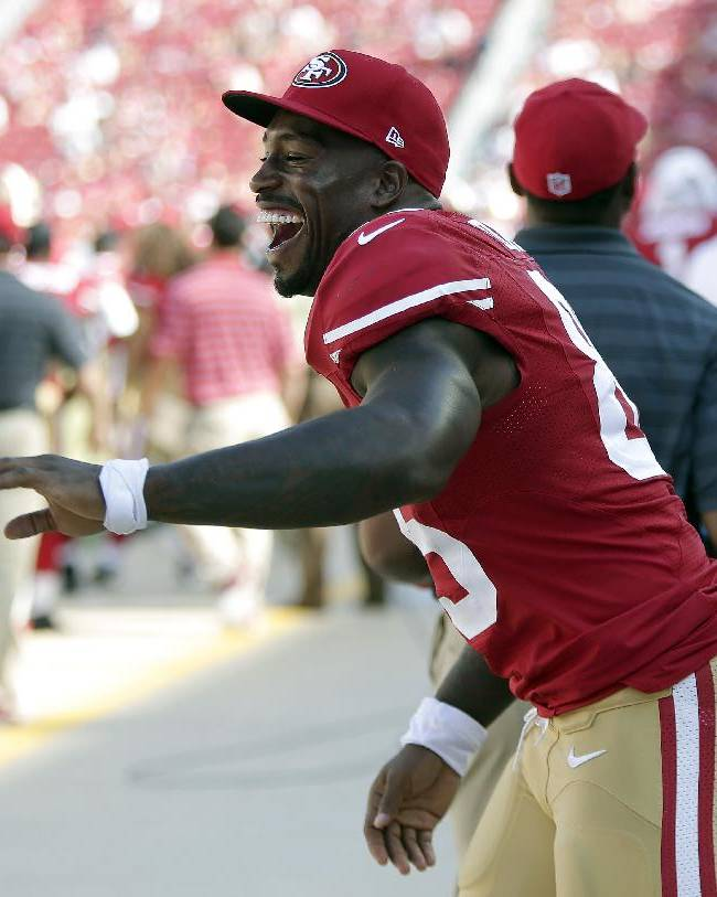 San Francisco 49ers tight end Vernon Davis celebrates on the sideline during the fourth quarter of an NFL preseason football game against the San Diego Chargers in Santa Clara, Calif., Sunday, Aug. 24, 2014. The 49ers won 21-7