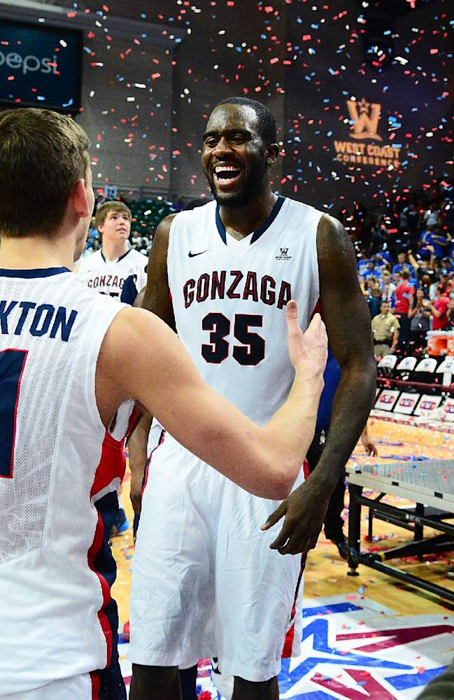 In this photo provided by the Las Vegas News Bureau, West Coast Conference All - Tournament stars David Stockton and Sam Dower Jr. of Gonzaga University celebrate their 75-64 victory over BYU in the conference championship game at The Orleans Arena in Las Vegas, Nevada.  Tuesday March 11, 2014