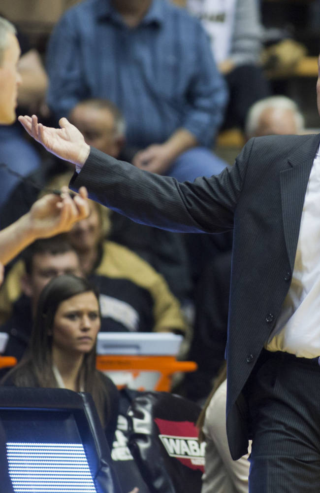 Ball State coach Brady Sallee, right, questions official Tom Hallead about a call during an NCAA college basketball game against Purdue, Sunday, Nov. 10, 2013, in West Lafayette, Ind. Purdue won 63-57