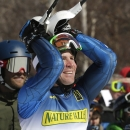 David Chodounsky, of Crested Butte, Colo., watches as Tim Kelly, who had the best time in the first run, stumbles on the bottom of the course during the second run of the men's slalom skiing race at the US Alpine Ski Championship in Carrabassett Valley, Maine, Sunday, March 29, 2015. Chodounsky won the race, and Kelly took third. (AP Photo/Charles Krupa)