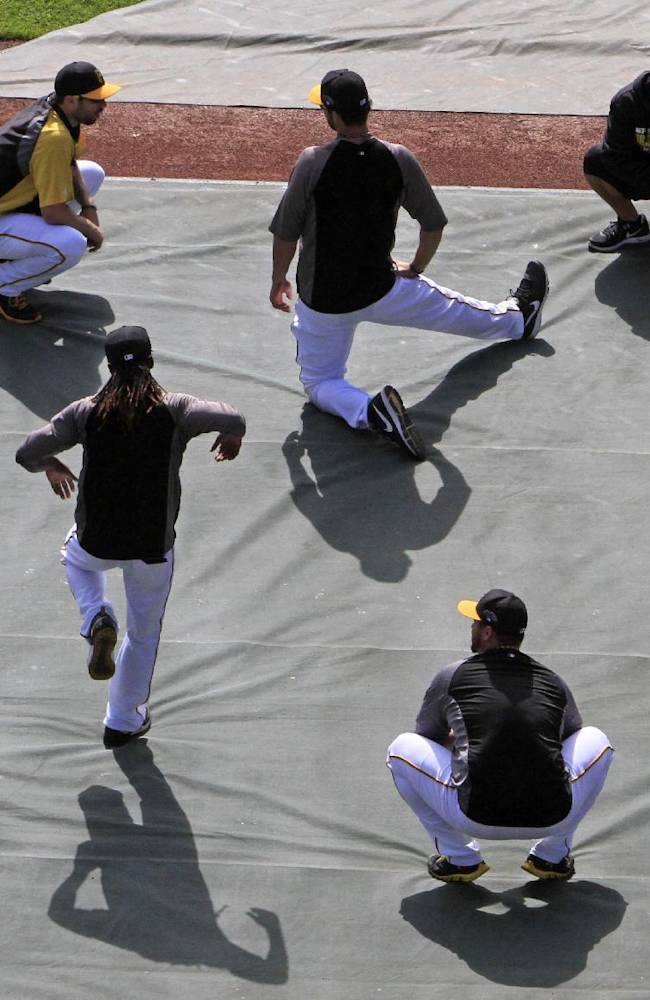 Pittsburgh Pirates' Andrew McCutchen, standing, does a dance move while stretching with teammates before Game 4 of a National League division baseball series against the St. Louis Cardinals on Monday, Oct. 7, 2013 in Pittsburgh