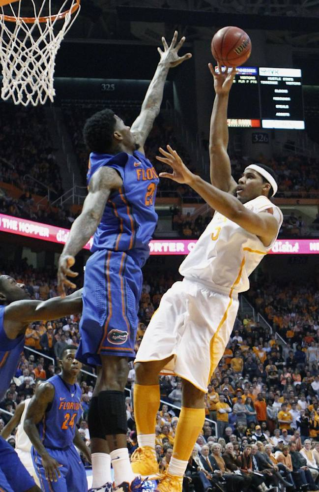 Tennessee forward Jarnell Stokes, right, shoots over Florida forward Casey Prather (24) in the first half of an NCAA college basketball game on Tuesday, Feb. 11, 2014, in Knoxville, Tenn