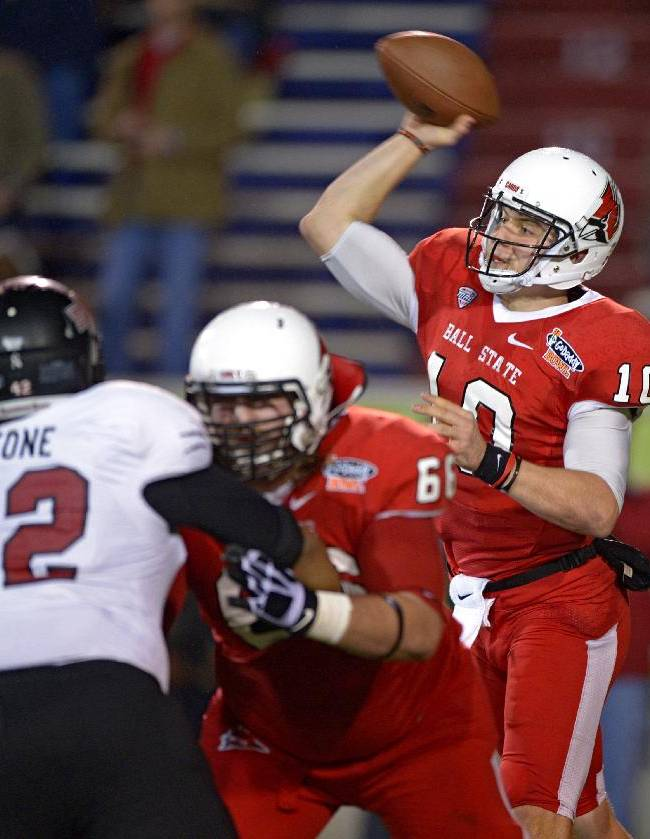Ball State quarterback Keith Wenning (10) throws as pass as offensive lineman Steven Bell (66) blocks Arkansas State defensive end Chris Stone (42) in the first quarter of the GoDaddy Bowl NCAA college football game, Sunday, Jan. 5, 2014, in Mobile, Ala