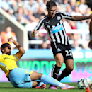 Newcastle United's Daryl Janmaat, right, vies for the ball with Crystal Palace's Fraizer Campbell, left, during their English Premier League soccer match at St James' Park, Newcastle, England, Saturday, Aug. 30, 2014