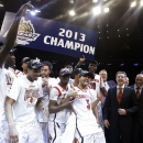 Louisville's Peyton Siva (3) celebrates with teammates after an NCAA college basketball championship game against Syracuse at the Big East Conference tournament, Saturday, March 16, 2013, in New York. Louisville won 78-61. (AP Photo/Frank Franklin II)