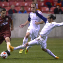 Real Salt Lake forward Sebastian Jaime, right, slides for the kick between Sacramento Republic FC defender James Kiffe, left, and Real Salt Lake defender Rich Balchan (25) during an exhibition soccer game in Sandy, Utah, Tuesday, Sept. 30, 2014 The Associ