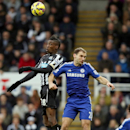 Newcastle United's Sammy Ameobi, left, vies for the ball with Chelsea's Branislav Ivanovic during their English Premier League soccer match at St James' Park, Newcastle, England, Saturday, Dec. 6, 2014