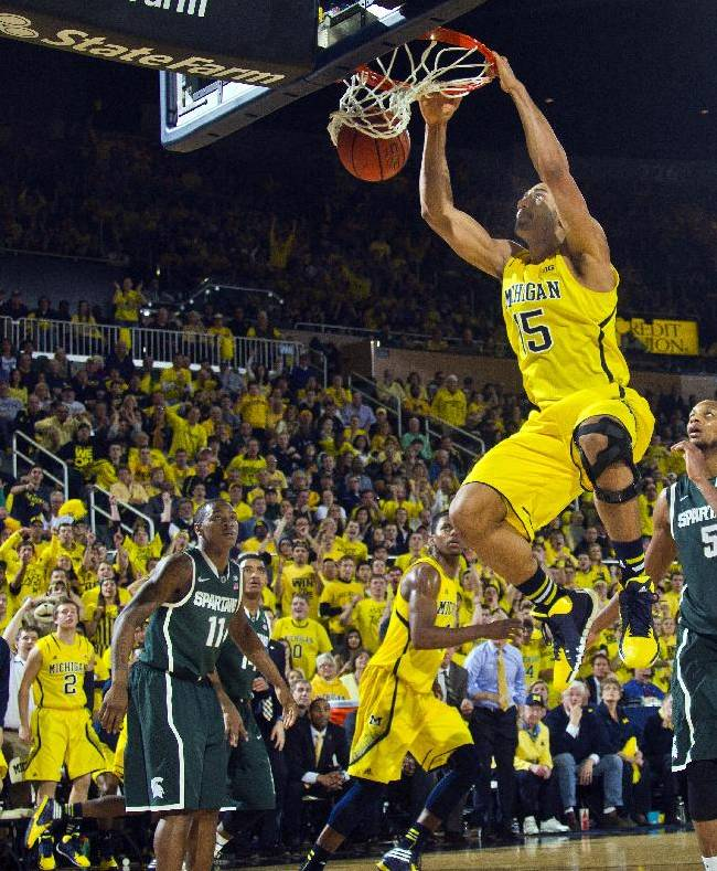 Michigan forward Jon Horford (15) slams a dunk in the second half of an NCAA college basketball game against Michigan State at Crisler Center in Ann Arbor, Mich., Sunday, Feb. 23, 2014. Michigan won 79-70