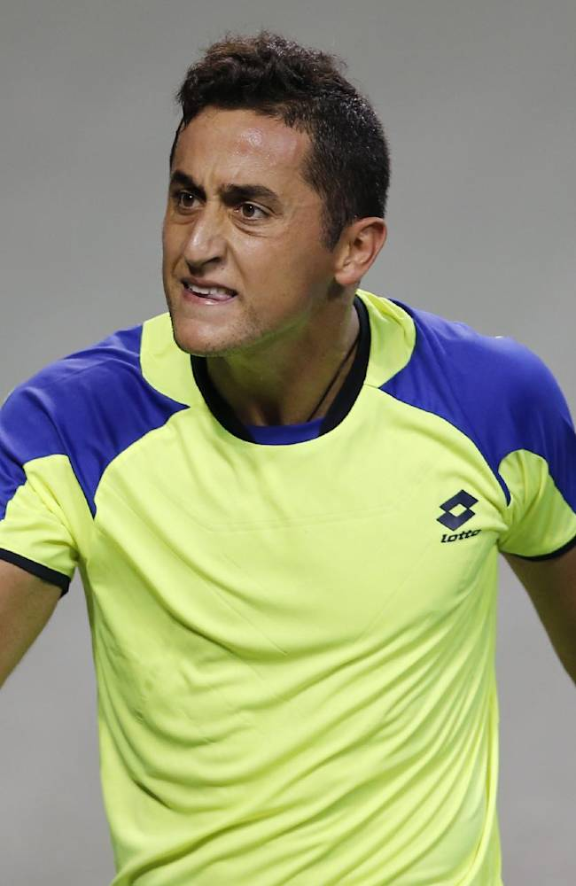 Nicolas Almagro of Spain celebrates a point won against Kei Nishikori of Japan during the quarterfinal of the Japan Open Tennis Championships in Tokyo Friday, Oct. 4, 2013. Almagro won the match, 7-6, 5-7, 6-3