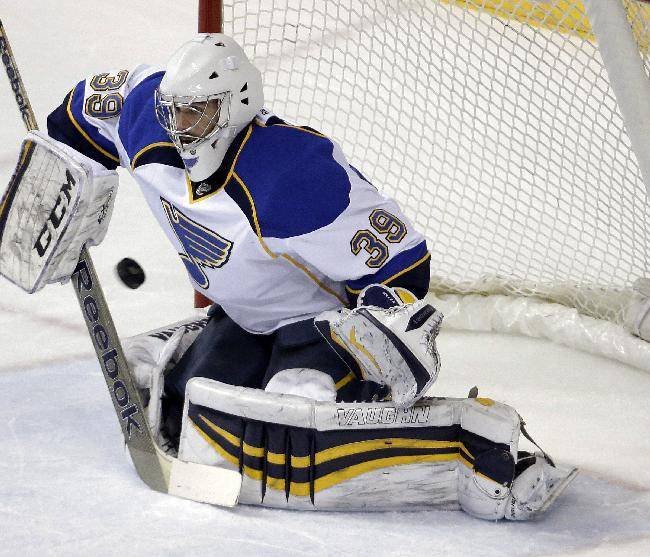 In this March 6, 2014 file photo, St. Louis Blues goalie Ryan Miller blocks a shot against the Nashville Predators in the first period of an NHL hockey game in Nashville, Tenn. NHL teams can begin making deals with free agents Tuesday, July 1, 2014