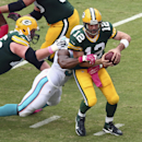 Rodgers rallies Packers past Dolphins 27-24 The Associated Press