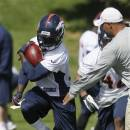 FILE - In this Monday, May 20, 2013, file phjoto,  Denver Broncos running back Ronnie Hillman takes part in drills during NFL football practice at the team's training facility in Englewood, Colo. (AP Photo/David Zalubowski, File)