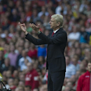 Arsenal's manager Arsene Wenger gestures during their English Premier League soccer match against Crystal Palace, at Emirates Stadium, in London, Saturday, Aug. 16, 2014