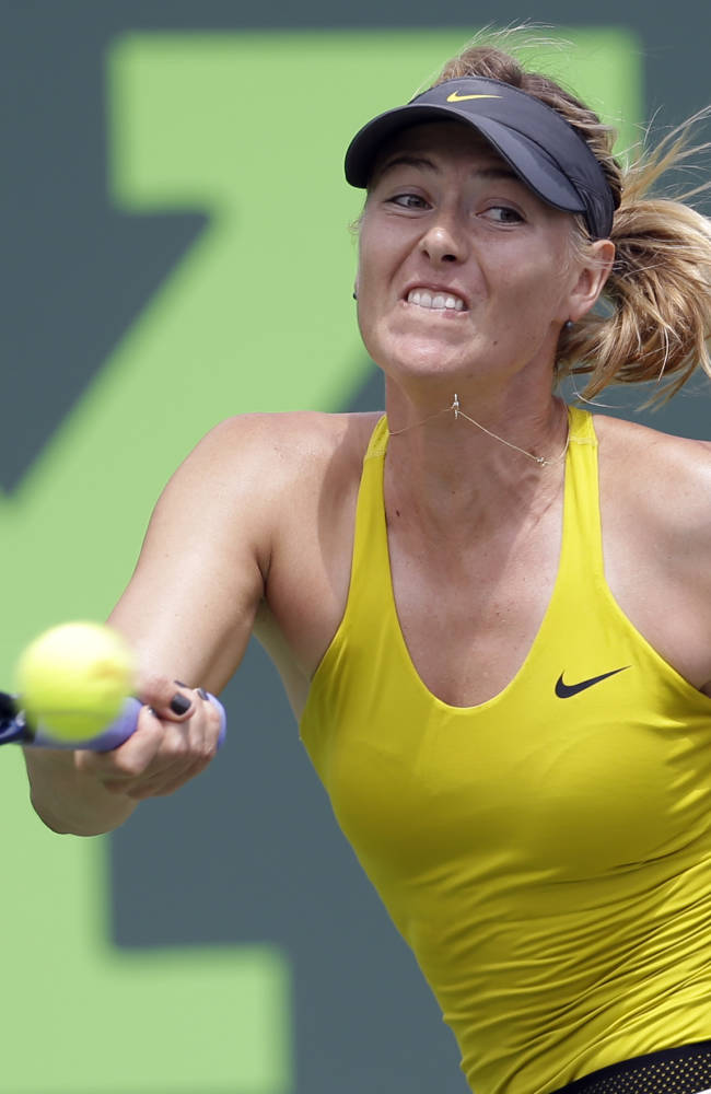 Maria Sharapova, of Russia, returns to Serena Williams at the Sony Open Tennis tournament in Key Biscayne, Fla., Thursday, March 27, 2014. Williams won 6-4, 6-3
