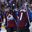 Colorado Avalanche center Paul Stastny (26) is congratulated by Colorado Avalanche goalie Semyon Varlamov (1) from Russia after scoring a goal against the Minnesota Wild to tie the game and send it to overtime during the third period in Game 1 of an NHL