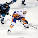 New York Islanders' Nick Leddy (2) is chased by San Jose Sharks' Andrew Desjardins (10) during the second period of an NHL hockey game Saturday, Nov. 1, 2014, in San Jose, Calif The Associated Press