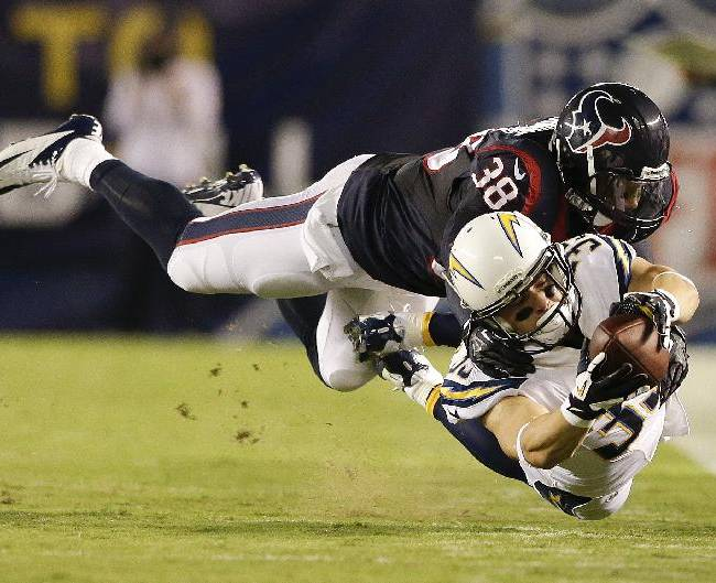 San Diego Chargers running back Danny Woodhead dives for extra yard under pressure from Houston Texans free safety Danieal Manning during the first half of an NFL football game Monday, Sept. 9, 2013, in San Diego