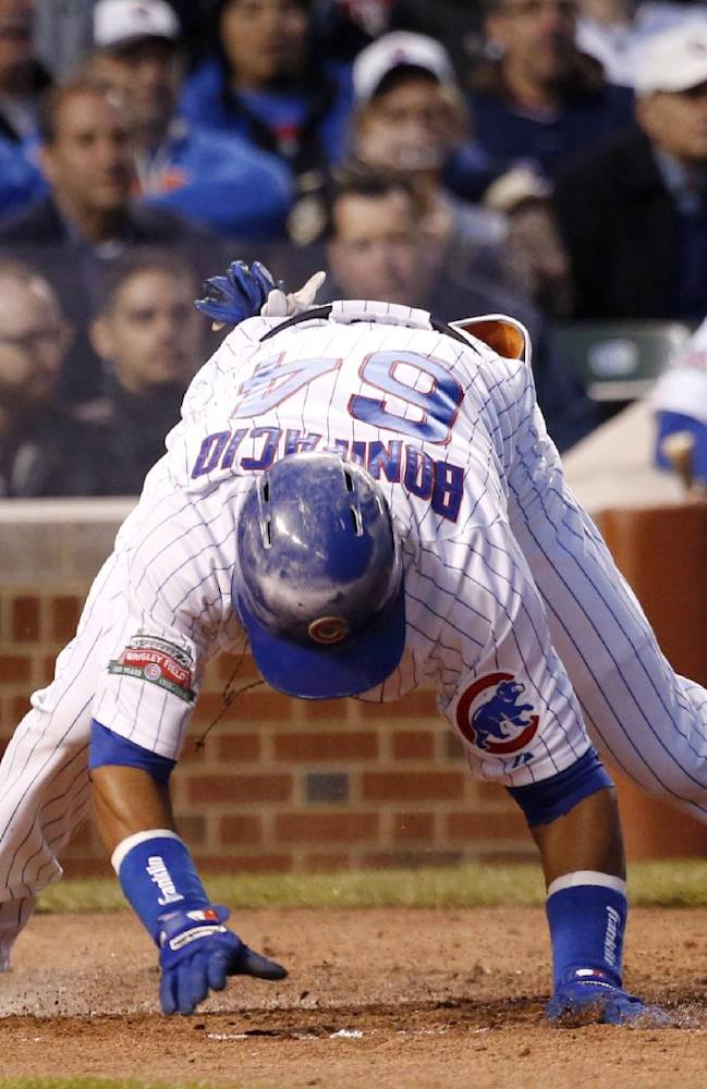 Chicago Cubs center fielder Emilio Bonifacio stumbles trying to get out of the batter's box after hitting the ball to Chicago White Sox first baseman Jose Abreu, during the third inning of a baseball game Tuesday, May 6, 2014, in Chicago