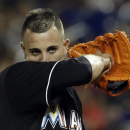 In this June 14, 2013 file photo, Miami Marlins' Jose Fernandez wipes his face during a baseball game against the St. Louis Cardinals in Miami. Fernandez won the NL Rookie of the Year On Nov. 11, 2013, making him the first Cuban to win the award since Jos