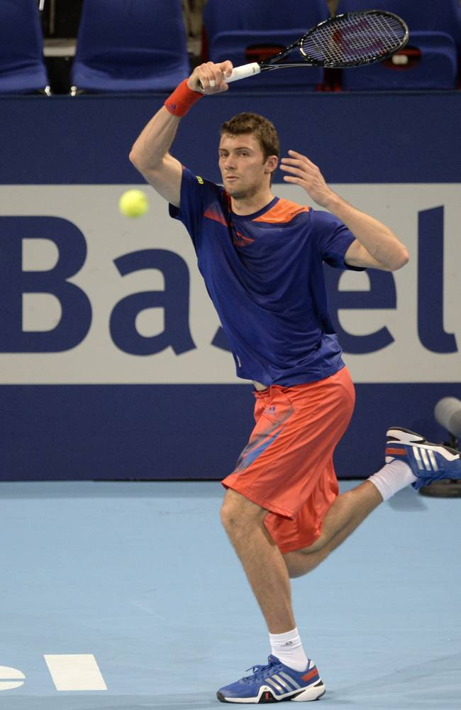 Germany's Daniel Brands returns a ball to France's Edouard Roger-Vasselin during their quarter final match at the Swiss Indoors tennis tournament at the St. Jakobshalle in Basel, Switzerland, on Friday, Oct. 25, 2013