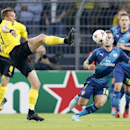 Dortmund's Kevin Grosskreutz, left, and Arsenal's Jack Wilshere challenge for the ball during the Champions League group D soccer match between Borussia Dortmund and Arsenal in Dortmund, Germany, Tuesday, Sept.16,2014