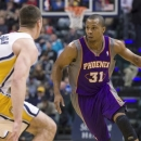 Phoenix Suns' Sebastian Telfair brings the ball up against Indiana Pacers' Tyler Hansbrough during the first half of an NBA b