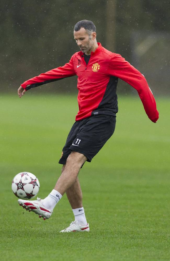 Manchester United's Ryan Giggs trains with teammates at Carrington training ground in Manchester, Tuesday, Oct. 22, 2013. Manchester United will play Real Sociedad in a Champion's League Group A soccer match on Wednesday
