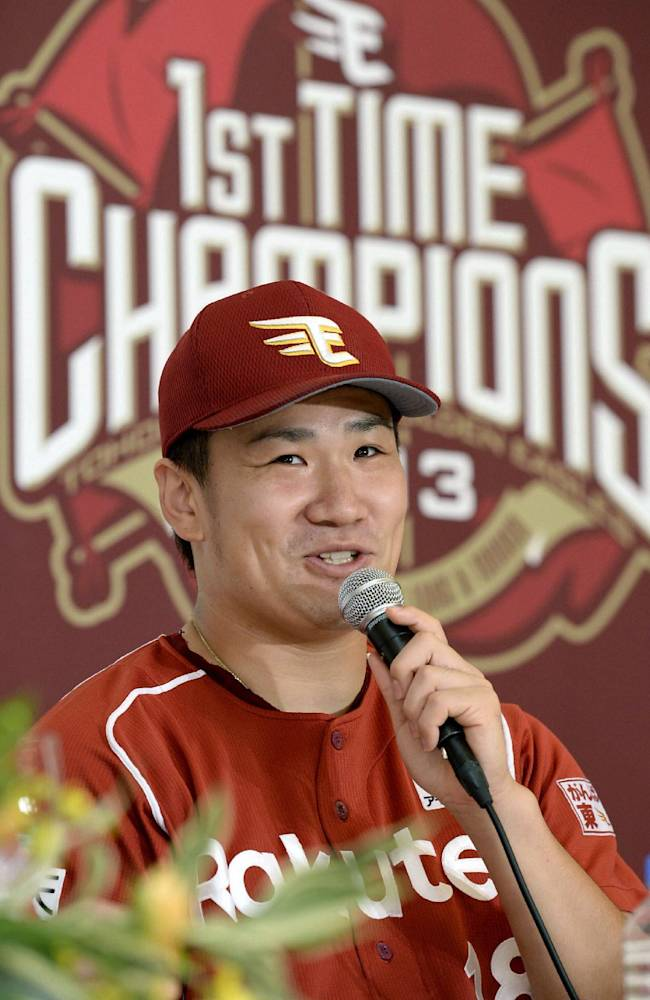 In this Thursday, Sept. 26, 2013 photo, Rakuten Eagles pitcher Masahiro Tanaka speaks at a news conference after defeating the Seibu Lions to clinch the team's first Pacific League franchise in Tokorozawa, Saitama Prefecture, northwest of Tokyo. Tanaka will be aiming to extend one of the most successful runs in the history of professional baseball when he takes the mound for the Rakuten Eagles in Game 1 of the Japan Series on Saturday, Oct. 26