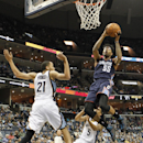 Charlotte Bobcats guard Chris Douglas-Roberts (55) goes to the basket against Memphis Grizzlies forward Tayshaun Prince (21) and guard Courtney Lee (5) in the first half of an NBA basketball game Saturday, March 8, 2014, in Memphis, Tenn The Associated Pr