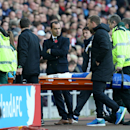 Everton manager Roberto Martinez, center,looks on at Gareth Barry as he is carried off the pitch during their English Premier League soccer match against Sunderland at the Stadium of Light, Sunderland, England, Sunday, Nov. 9, 2014