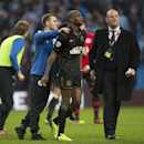 Wigan's Emmerson Boyce, centre, is congratulated by teammate Callum McManaman, centre left, after their 2-1 win against Manchester City following their English FA Cup quarterfinal soccer match at the Etihad Stadium, Manchester, England, Sunday, March 9, 2