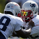 New England Patriots running back James White (28) and running back Stevan Ridley run a drill during NFL football training camp in Foxborough, Mass., Saturday, July 26, 2014. (AP Photo) The Associated Press