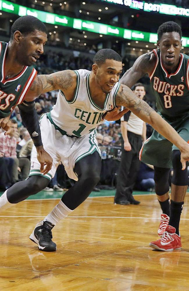 Bucks rally for 105-98 win in Celtics home opener