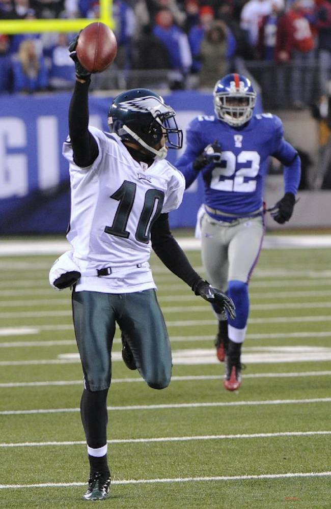 In this Dec. 19, 2010, file photo, Philadelphia Eagles' DeSean Jackson returns a punt for a touchdown during the fourth quarter of the NFL football game against the New York Giants in East Rutherford, N.J. The Eagles won 38-31. The Eagles have enjoyed some of their greatest moments on the road against the Giants. Chip Kelly, the Eagles' coach, certainly doesn't need a refresher course before Sunday's game between the two struggling teams. He knows Philadelphia (1-3) and New York (0-4) go back a long way