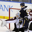 Colorado Avalanche's goalie Semyon Varlamov (1), of Russia, and Nathan MacKinnon (29) defend against St. Louis Blues' Jaden Schwartz (9) during the third period of an NHL hockey game, Saturday, April 5, 2014, in St. Louis The Associated Press