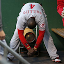 Cincinnati Reds' Brandon Phillips (4) stands in front of a heater in the dugout before a baseball game against the Pittsburgh Pirates in Pittsburgh on Wednesday, April 23, 2014 The Associated Press