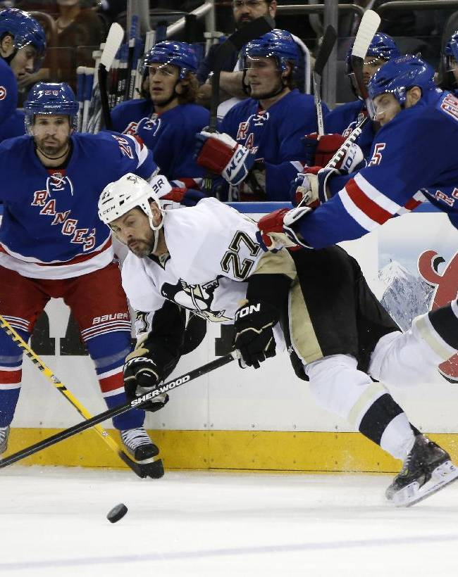 New York Rangers defenseman Dan Girardi (5) checks Pittsburgh Penguins right wing Craig Adams (27) of Brunei as New York Rangers right wing Martin St. Louis (26) looks on in the third period of their second-round NHL Stanley Cup hockey playoff game at Madison Square Garden in New York, Monday, May 5, 2014.  The Penguins shutout the Rangers 2-0 to take a 2-0 lead in the series