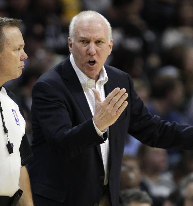 San Antonio Spurs coach Greg Popovich talks to referee Bill Spooner in the third quarter of the Spurs' NBA basketball game against the Denver Nuggets in Denver on Tuesday, Nov. 5, 2013. San Antonio defeated Denver 102-94