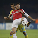 Arsenal's Oliver Giroud holds back Napoli midfielder Christian Maggio during a Champions League, group F soccer match, at the Naples San Paolo stadium, Italy, Wednesday, Dec. 11, 2013