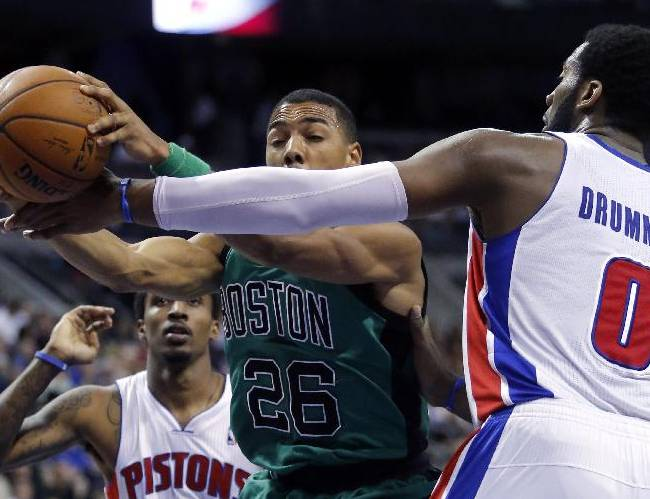 Boston Celtics guard Phil Pressey (26) is fouled by Detroit Pistons center Andre Drummond (0) while driving the lane during the second half of an NBA basketball game Saturday, April 5, 2014, in Auburn Hills, Mich. The Pistons defeated the Celtics 115-111
