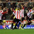 Sunderland's captain John O'Shea, right, celebrates his goal during their English Premier League soccer match against Chelsea at the Stadium of Light, Sunderland, England, Wednesday, Dec. 4, 2013. (AP Photo/Scott Heppell)